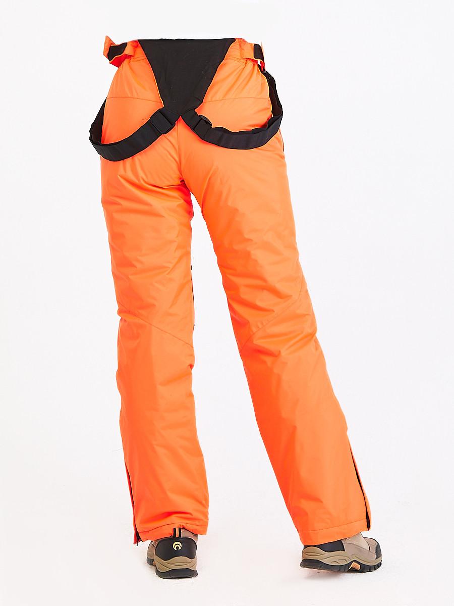 Купить оптом Брюки горнолыжные женские оранжевого цвета 818O в Сочи