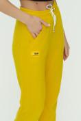 Оптом Штаны джоггеры женские желтого цвета 1302J в Екатеринбурге, фото 11