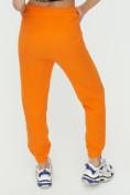 Оптом Штаны джоггеры женские оранжевого цвета 1302O в Казани, фото 13
