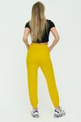 Оптом Штаны джоггеры женские желтого цвета 1302J в Екатеринбурге, фото 5