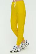Оптом Штаны джоггеры женские желтого цвета 1302J в Екатеринбурге, фото 8