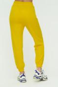 Оптом Штаны джоггеры женские желтого цвета 1302J в Екатеринбурге, фото 9
