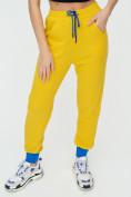 Оптом Спортивные брюки женские желтого цвета 1307J в Екатеринбурге, фото 6