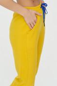 Оптом Спортивные брюки женские желтого цвета 1307J в Екатеринбурге, фото 17