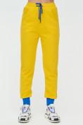 Оптом Спортивные брюки женские желтого цвета 1307J в Екатеринбурге, фото 7