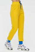 Оптом Спортивные брюки женские желтого цвета 1307J в Екатеринбурге, фото 8