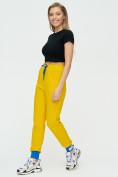 Оптом Спортивные брюки женские желтого цвета 1307J в Екатеринбурге, фото 4