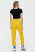 Оптом Спортивные брюки женские желтого цвета 1307J в Екатеринбурге, фото 5