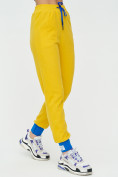 Оптом Спортивные брюки женские желтого цвета 1307J в Екатеринбурге, фото 9