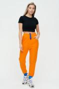 Оптом Спортивные брюки женские оранжевого цвета 1307O в Екатеринбурге