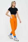 Оптом Спортивные брюки женские оранжевого цвета 1307O в Екатеринбурге, фото 3