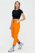 Оптом Спортивные брюки женские оранжевого цвета 1307O в Екатеринбурге, фото 4