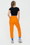 Оптом Спортивные брюки женские оранжевого цвета 1307O в Екатеринбурге, фото 5