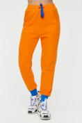 Оптом Спортивные брюки женские оранжевого цвета 1307O в Екатеринбурге, фото 7