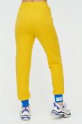 Оптом Спортивные брюки женские желтого цвета 1307J в Екатеринбурге, фото 11