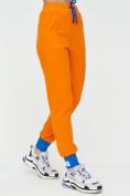 Оптом Спортивные брюки женские оранжевого цвета 1307O в Екатеринбурге, фото 8