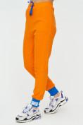 Оптом Спортивные брюки женские оранжевого цвета 1307O в Екатеринбурге, фото 9