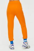 Оптом Спортивные брюки женские оранжевого цвета 1307O в Екатеринбурге, фото 10