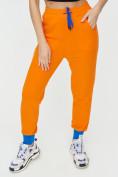 Оптом Спортивные брюки женские оранжевого цвета 1307O в Екатеринбурге, фото 12