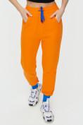Оптом Спортивные брюки женские оранжевого цвета 1307O в Екатеринбурге, фото 13