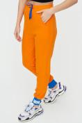 Оптом Спортивные брюки женские оранжевого цвета 1307O в Екатеринбурге, фото 15