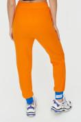 Оптом Спортивные брюки женские оранжевого цвета 1307O в Екатеринбурге, фото 16