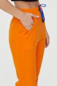 Оптом Спортивные брюки женские оранжевого цвета 1307O в Екатеринбурге, фото 17