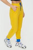 Оптом Спортивные брюки женские желтого цвета 1307J в Екатеринбурге, фото 12