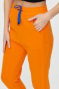 Оптом Спортивные брюки женские оранжевого цвета 1307O в Екатеринбурге, фото 18