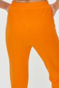 Оптом Спортивные брюки женские оранжевого цвета 1307O в Екатеринбурге, фото 19