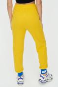 Оптом Спортивные брюки женские желтого цвета 1307J в Екатеринбурге, фото 14
