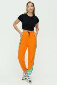 Оптом Штаны джоггеры женские оранжевого цвета 1309O в Екатеринбурге