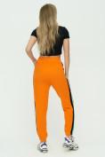 Оптом Штаны джоггеры женские оранжевого цвета 1309O в Екатеринбурге, фото 6