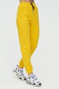 Оптом Штаны джоггеры женские желтого цвета 1312J в Казани, фото 9
