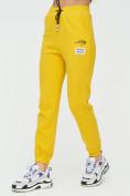 Оптом Штаны джоггеры женские желтого цвета 1312J в Казани, фото 10