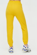 Оптом Штаны джоггеры женские желтого цвета 1312J в Казани, фото 11