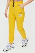 Оптом Штаны джоггеры женские желтого цвета 1312J в Казани, фото 15