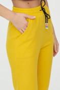 Оптом Штаны джоггеры женские желтого цвета 1312J в Казани, фото 18