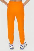 Оптом Штаны джоггеры женские оранжевого цвета 1312O в Екатеринбурге, фото 13