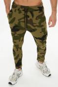 Оптом Трикотажные брюки зауженные камуфляжного цвета 227001Kf в Екатеринбурге